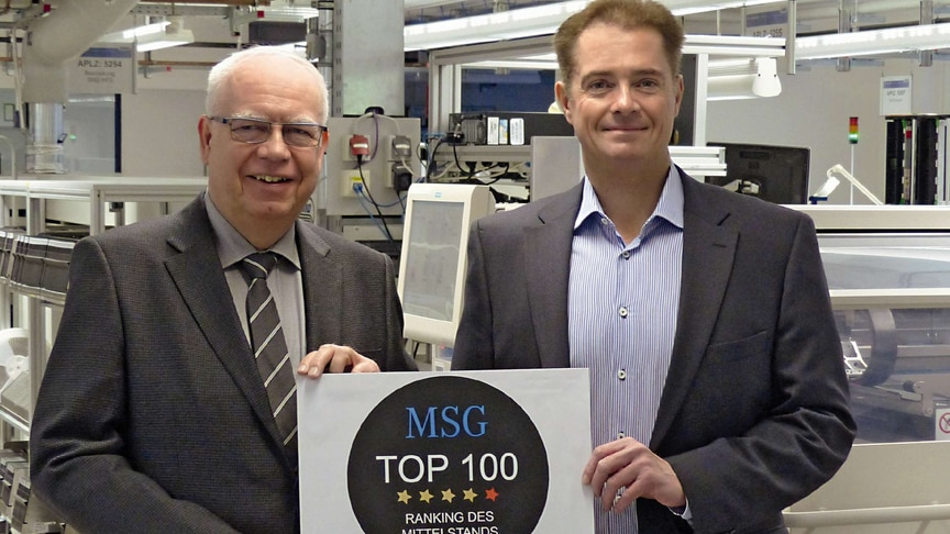 Bernhard and Michael Juchheim with the award to the Top 100 medium-sized company by MSG